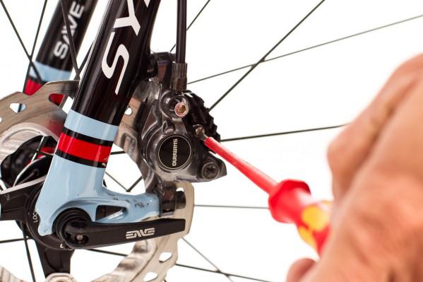 Pad exchange - step 1: remove splint pin, turn screw outward