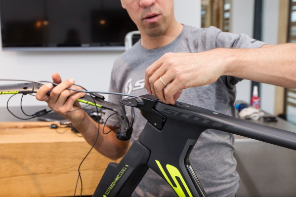 Pass the brake cable housings of the front brake through the stem. Then route the rear cable housing through the down tube of the frame.