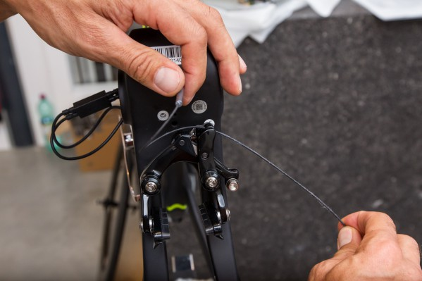 Pass the inner cable through the outer casing and through the recess below the inner cable fixing bolt...